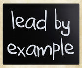 """Lead by example"" handwritten with white chalk on a blackboard — Stok fotoğraf"