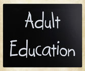 """Adult Education"" handwritten with white chalk on a blackboard — Stock Photo"