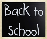 """Back to school"" handwritten with white chalk on a blackboard — Foto Stock"