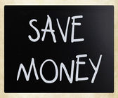 """Save money"" handwritten with white chalk on a blackboard — Stock Photo"