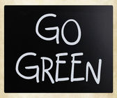 """Go green"" handwritten with white chalk on a blackboard — Stock Photo"