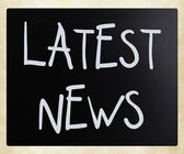 """Latest news"" handwritten with white chalk on a blackboard — Stock Photo"