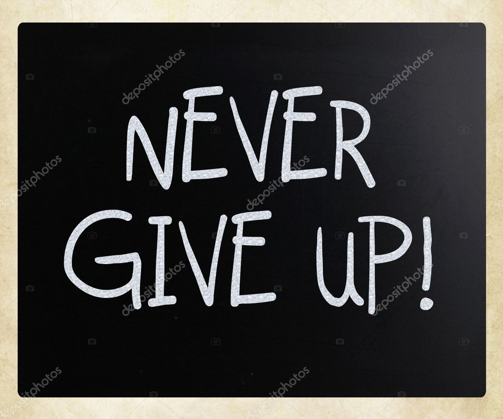 Never give up handwritten with white chalk on a blackboard — Stock Photo #9717168