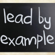 """Lead by example"" handwritten with white chalk on a blackboard — Stock Photo #9979965"