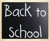 """Back to school"" handwritten with white chalk on a blackboard — Foto de Stock"