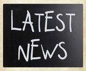 """Latest news"" handwritten with white chalk on a blackboard — Stock Photo"