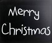 """Merry Christmas"" handwritten with white chalk on a blackboard — Foto Stock"