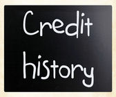 """Credit history"" handwritten with white chalk on a blackboard — Stock Photo"