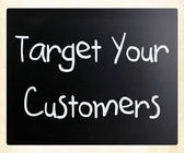 """Target your customers"" handwritten with white chalk on a blackb — Stock Photo"