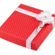 Red gift with ribbon — Stock Photo