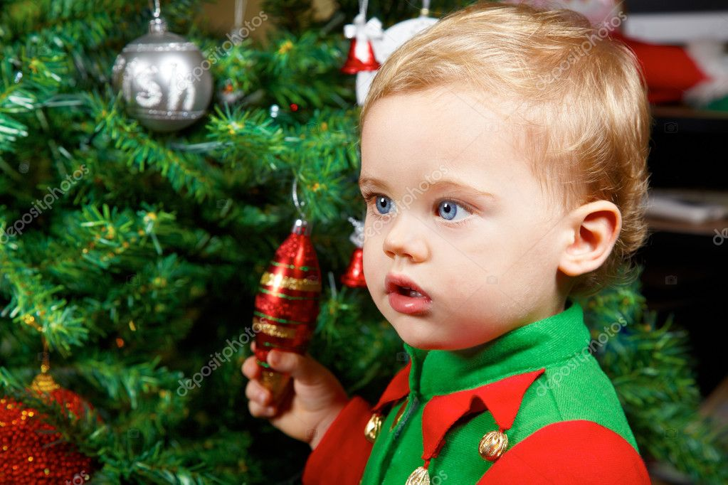 1 year old baby boy portrait by the Christmas tree. — Stock Photo #8296485