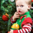 Baby by the Christmas tree — Stock Photo