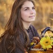 Young womwith flower basket — Stock Photo #8372444