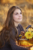 Young woman with flower basket — Stock Photo