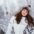 图库照片: Young woman having fun in winter