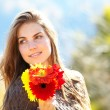Woman with flowers outdoor - Stock Photo