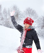 Young woman playing with snow — Stock Photo