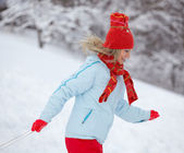 Woman running through the snow — Stock Photo