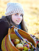 Young woman with fruit basket — Stock Photo