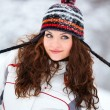 Young woman playing in the snow — Stok fotoğraf