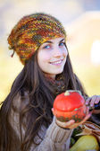Woman with small pumpkin — Stock Photo