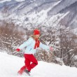 Woman running through snow - Stock Photo