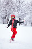 Woman running through snow — Stock Photo