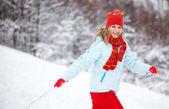 Woman running through snow — Stock Photo