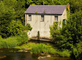Mill on Liffey river — Stock Photo