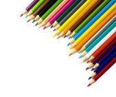 Multi colored pencils in a corner on white background — Stock Photo