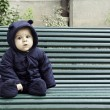 Baby boy sitting alone outdoors — Stock Photo