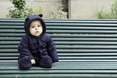 Baby boy sitting alone outdoors — Stockfoto