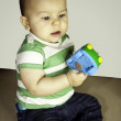 Baby child boy playing with toys — Stock Photo