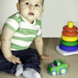 Baby child with toys portrait — Stock Photo
