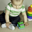 Baby child with toys playing with toys — Stock Photo