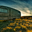 Camper trailer backlit by the sun during a beautiful sunset — Stock Photo