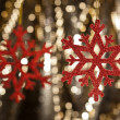 Royalty-Free Stock Photo: Red snow flake on a gold glitter background