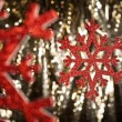 Red snow flake on a gold glitter background — Stock Photo #10415326