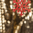 Red snow flake on a gold glitter background — Stock Photo #10415486