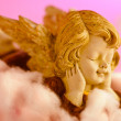 Angel resting on clouds and enjoying the sun — Stock Photo