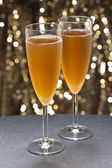 Champaign glass in front of glitter background — Stock Photo