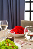 Inside interior table setting with beautiful salad and one plate — Stock Photo