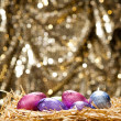 Chocolate Easter eggs in a natural straw nest — Lizenzfreies Foto