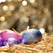 Chocolate Easter eggs in a natural straw nest — Stock Photo