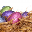 Straw nest with chocolate Easter eggs — Stock Photo