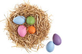 Straw nest with nice colored Easter eggs — Stock Photo