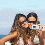 Twins taking a photo — Stock Photo