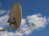 Home TV antenna on blue sky background — Stock Photo