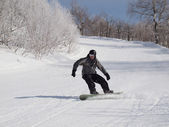 Snowboarder on the mountain slope. — Стоковое фото
