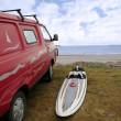 Stock Photo: Windsurfers van and board at beach